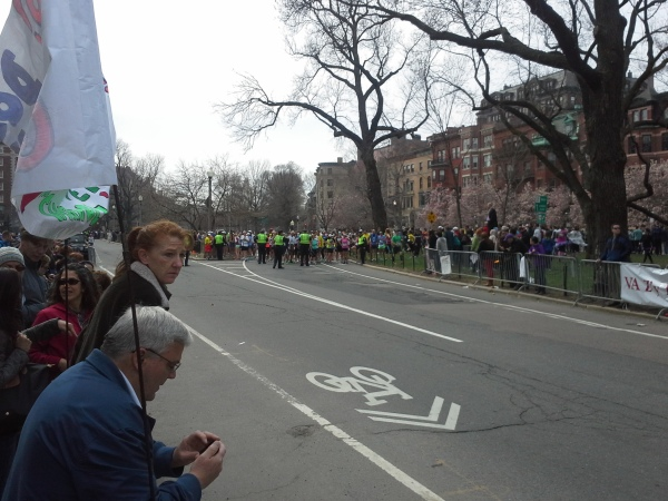 Police stopping the Boston Marathon just steps away.