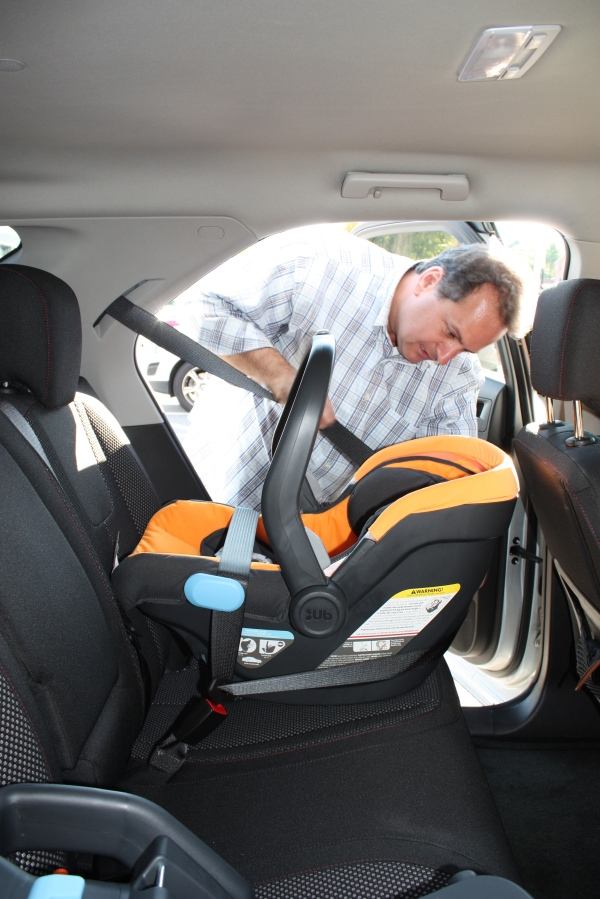 AJ practiced installing the Carrier without the base using the Lap/Shoulder Belt European Routing Method - great for quick cab rides around town and vacation! Looking like a real Dad, AJ!